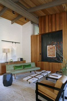 This beautiful mid-century modern and vintage home interior designed by Charles DeLisle is located in Portola Valley, California