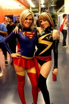Characters: Supergirl (Kara Zor-El) & Ms. Marvel (Carol Danvers) / From: DC Comics & MARVEL Comics / Cosplayers: Unknown