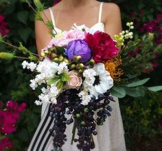 Fill your bridal bouquet with beautiful colors- bright purple, pink, and fuchsia flowers, mixed with wild greenery, berries and bold stripes.  Love this bouquet?  Make it yourself with silk flowers from Afloral.com.  Follow this easy video from The Faux Bouquets and Afloral.com for your DIY bridal bouquet.