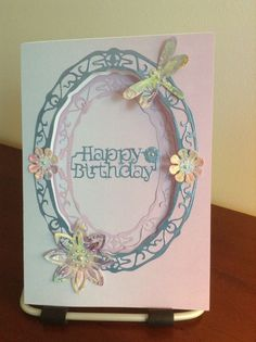 Unfortunately I don't know who to credit with this beautiful card. I would use Tonic Oval dies to make it.