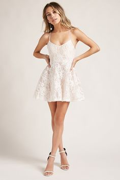 A woven netted guipure lace dress featuring a V-neckline, padded cups, crisscross back cami straps, a back zipper closure, and a fit-and-flare silhouette. (This item runs small, please size up.)<p>- This is an independent brand and not a Forever 21 branded item.</p>