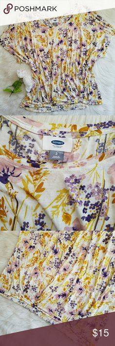 Old Navy Floral Blouse Old Navy brand.  Women's size Large.  Yellow purple watercolor floral pattern. Pleated front.  Short dolman sleeves.  New without tags. Never worn. Old Navy Tops Blouses