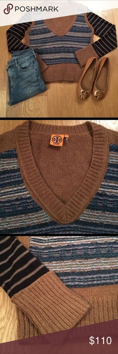 Tory Burch V Neck sweater Tory Burch v neck sweater size medium. Bought it on posh and never wore it. Such an amazing looking sweater. Just too hot in Arizona so I'm losing out but it's better than sitting in my closet :) Tory Burch Sweaters V-Necks