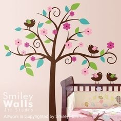 How cute is this baby girl room? I love the owl decor that's 'in' now, but I really love these little birds :)