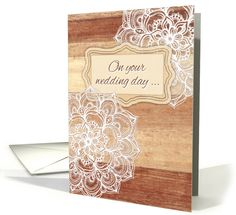 Congratulations on your wedding day, white doodles on wood card. An elegant, feminine card with lacy, hand drawn, doodled floral mandalas.