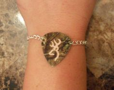 Mossy Oak Camo with light pink browning deer symbol guitar pick bracelet jewelry from featherpick on Etsy. Saved to Camo Camo Jewelry, Guitar Pick Jewelry, Jewelry Bracelets, Jewlery, Browning Symbol, Browning Deer, Country Outfits, Country Girls, Camouflage