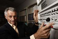 """As Facebook grows, millions say, 'No, thanks.'    """"In this Aug. 25, 2009 photo, Internet pioneer Len Kleinrock poses for a portrait next to an Interface Message Processor, which was used to develop the Internet. Kleinrock, arguably the world's first Internet user, says Facebook is fine for his grandchildren, but it's not for him."""""""