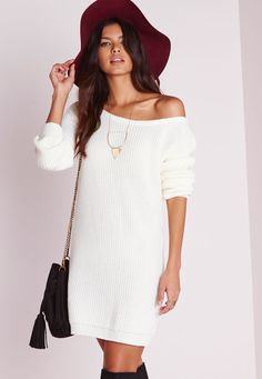 This off the shoulder knitted sweater dress in a shade of cream is one super snug wear. Your guaranteed to look majorly cute in this hot little sweater dress. Style yours with some sexy heeled sandals, fringed shoulder bag and bed head hair...