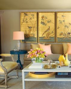 Looking at this room of subdued peaches and tans, the color contrasts may not be obvious. However, the accent pieces -- end tables painted Lancaster Blue and a tray coated in Babouche yellow -- are complementary colors that bring modern pop to the formal setting. And the exterior of the lampshades are painted peach to project the flattering color. See More Superneutral Palettes