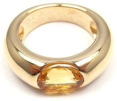 CARTIER Ellipse Large Citrine Yellow Gold Ring   From a unique collection of vintage band rings at http://www.1stdibs.com/jewelry/rings/band-rings/