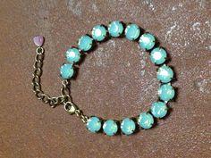 Swarovski pacific opal tennis bracelet swarovski jewelry austrian crystal bracelet crystal jewelry not sabika. $35.00, via Etsy.