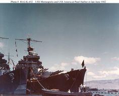 USS Astoria (CA 34) (center), and USS Minneapolis (CA 36) (left) moored near Aiea Landing, Pearl Harbor, in late June 1942.