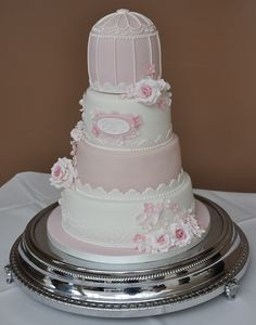 Wedding Cake with bird cage in pale dusky pinks.