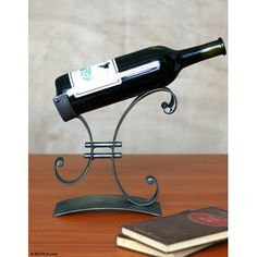 Buy Iron wine bottle holder, 'Close to You' today. Shop unique, award-winning Artisan treasures by NOVICA, the Impact Marketplace.