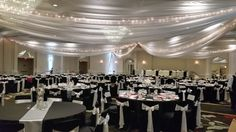 White ceiling draping with lights as well as chair covers and linens really make this couple's reception stand out - another beautiful day at the Hilton!