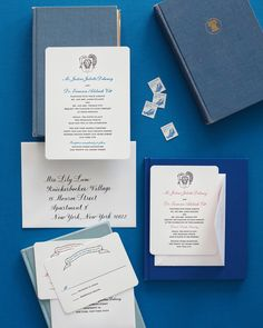 A quirky coat of arms featuring an Alaskan musk ox and herring (a reference to the groom's time spent in Alaska) adorned this couple's letterpressed invitation suite.