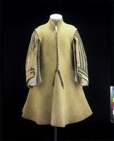 The buff coat was a feature of military dress during the 17th century, usually worn under a breastplate. Originally these garments were made of European buffalo (or wild ox) hide, which is where the term 'buff' comes from. By the mid-17th century, they were most frequently made of oil-tanned cow leather. The thick leather made the coat good protection, not only against musket balls and sword cuts, but also from the friction of the armoured plate worn over it.
