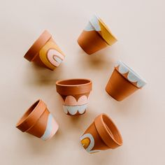 These Painted Terracotta Pots make a cute DIY Gift! Painted Plant Pots, Painted Flower Pots, Paint Garden Pots, Painted Pebbles, Hand Painted, Leather Strap Shelves, Cute Diys, Terracotta Pots, Diy On A Budget