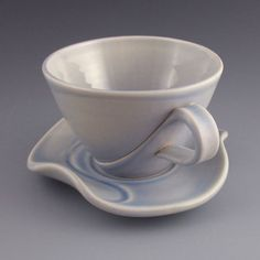 Would be cool as both a traditional handled cup and a bowl that sits down into a cup