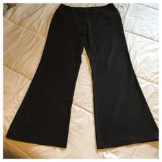 "Rue 21 Black Dress Pants Cute black dress pants that have a pinstripe look with a wide leg. Waist 17 1/2"", inseam 31"", leg opening 11""  Does have some pilling, but only on the inside near the tag and along some seams. Rue 21 Pants Wide Leg"