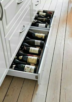 Bottom drawer filled with wine bottles. Great idea.
