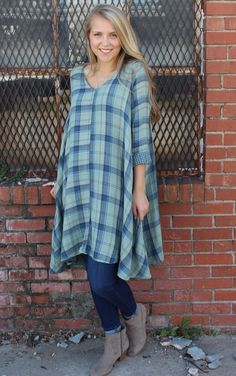 Lightweight swing dress with cuffed sleeves and v-neckline. Double layer light green & deep blue plaid with a small check of blue & green on inside.