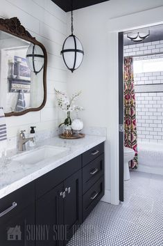 I love this Black and White bathroom remodel, vintage with a hint of industrial. The wall above the vanity is shiplapped and there is a marble countertop. The tub surround is a basic white subway tile with charcoal grout with a boarder of white penny tile White Subway Tile Bathroom, Black White Bathrooms, Black And White Tiles, Small Bathroom, Bathroom Black, White Marble, Condo Bathroom, Penny Tile Bathrooms, Black And White Bathroom Ideas