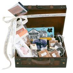 Tuck Box hamper: Antique Style Wooden Suitcase offering a great selection of goodies for a treat! Excellent gift for those that have gone off to school or university or just for self-indulgence! This great useful case is filled with 8 mouth-watering items.