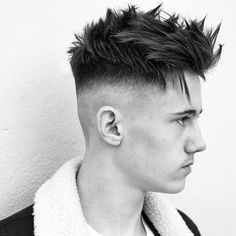 high skin fade, spiky textured hair on top