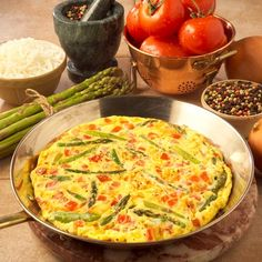 Asparagus Frittata  Fresh asparagus, Swiss cheese and fresh tomatoes adorn this open-face omelet.