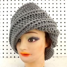 I like the way the extended flap on this diagonal hat makes you look taller. Celebrate the crochet Judy beanie hat in gray with an extra wide brim and a wide horizontal ribbed texture. It flows beautifully within itself. Get the same comfort in a loose fit. Tuck in or untuck the