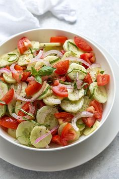 Cucumber Tomato Salad seasoned with dill and fresh basil in a homemade vinaigrette - An easy, healthy and flavorful side salad! #cucumbertomatosalad #cucumbersalad Cucumber Tomato Salad, Cucumber Recipes, Healthy Salad Recipes, Marinated Cucumbers, Vegan Recipes, Orzo, Cilantro, Quinoa, Feta