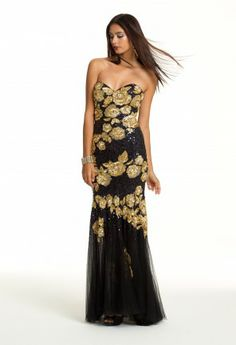 Feed into your floral obsession in the classiest possible by wearing this dazzling Jovani dress on your prom night! The contrast between the gold sequin beaded flowers and black mesh fabrication creates a two-toned look that is unlike any other. This mermaid shaped strapless dress definitely makes a statement in our Prom 2013 collection. Wear this dress with all of the confidence in the world because no one will upstage this unique dress design. Compliment this dress with fabulous accessories...