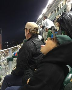"""""""One is busy watching the game, the other is busy catching rain. #boys #sicem"""""""