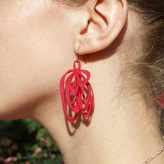 Ribbon Earrings Pink now featured on Fab. AMINIMAL StudioHip Scientific Jewelry  Svetlana Blum Briscella and John Briscella are the creative minds behind AMINIMAL Studio. Based in Brooklyn, their hip and inspired collection of jewelry mimics the pattern of solar flares. Back again on Fab, these complex and highly creative designs turn imagination and art into function.