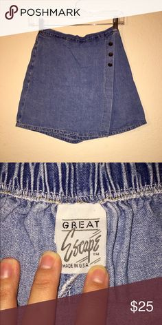 Vintage Denim Skort Vintage denim skirt with three brass-colored buttons in the front. This is a high waisted skort that was made here in the USA! The elastic waist measures about 27 inches. Listed as Urban Outfitters for visibility. Urban Outfitters Shorts Skorts