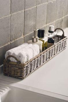 Spa Retreat: Add a shelf or basket to the tub for a luxury hotel feel in the bathroom! #spabathroom #bathroomideas