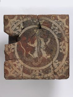 This tile was once part of a highly decorated floor at Chertsey Abbey, Surrey.. The tilers working at Chertsey during the second half of the thirteenth century produced work that was both decoratively and technically of the highest quality. The creature depicted on this tile may be related to signs of the zodiac, although an identification with Scorpio is uncertain. Chertsey Abbey was dissolved by Henry VIII in 1537.