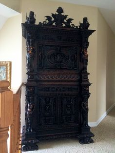 Spanish Eighteen Century Heavily Carved Royal Cabinet. The carving on this piece as been created by a Master Artist the quality is better than top quality...  I have been told the points on the crown are positions away from the throne.