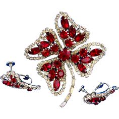 Hobe Red Rhinestone Shamrock Brooch and Earring Set offered at Ruby Lane