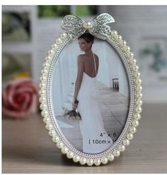 Cheap wedding photo frame, Buy Quality picture frame directly from China photo frame Suppliers: Hot Sale Home & Table Deco Item Metal Alloy Wedding Photo Frame Picture Frame With Pearls and Rhinestones Decoration Metal Photo Frames, Photo Picture Frames, Picture Frame Decor, Foto Frame, Pearl Crafts, Jewelry Frames, Vintage Jewelry Crafts, Wedding Frames, Diy Frame