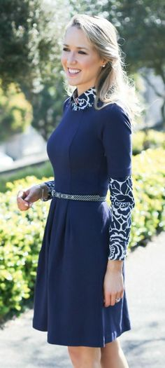 knit short sleeve tulip skirt navy dress layered over navy and white floral print button down collared shirt