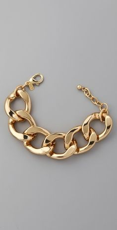 Kenneth Jay Lane produces eye catching pieces including this timeless gold bracelet- so inspiring!