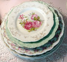 a stack of vintage rose china plates (photo by seaside rose garden)