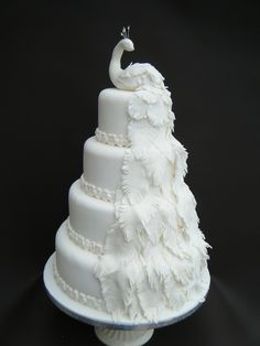 All white cake with sugar past peacock #wedding #weddingcake