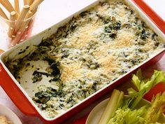 Gorgonzola Spinach Artichoke Dip : This twist on classic spinach artichoke dip is sure to be a winner at any holiday dinner or get-together. Rachael Ray serves it with sesame breadsticks, celery hearts and pita crisps for dipping.
