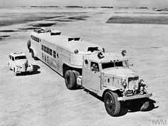 "Marmon-Herrington THD-315-6 with articulated omnibus trailer used by the RAF for the 1,300-mile duty transport run between Habbaniyah, Iraq, and Damascus, Syria. Originally an oilfield pipe carrier, it was taken over by the RAF in 1943. Known as the ""Monster Bus"" in RAF service it carried 44 passengers and their luggage, was fully air-conditioned and was equipped with a kitchen, lavatory and iced-water on tap."