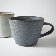 Muted tones for a muted rainy day. Production has been slow round these parts lately. Lots in progress but not many finished pieces. But I have been testing, testing, testing and sloooowly developing some new glazes and finishes. #wheelthrown #stoneware #cup #mug #grey #clay #ceramics #australianceramics