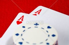 pair of ace and chips - Pair of ace with a blurred chips on top.