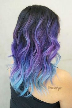 From Dark Purple To Light Blue Ombre Hairstyle #wavyhair #layeredhaircut #longhair★Explore galaxies with blue and purple hair color ideas. Pick a light pastel option or bright ombre, mermaid hair, or highlights. ★ See more: http://glaminati.com/blue-and-purple-hair-looks/ #blueandpurplehair #galaxyhair #glaminati #lifestyle